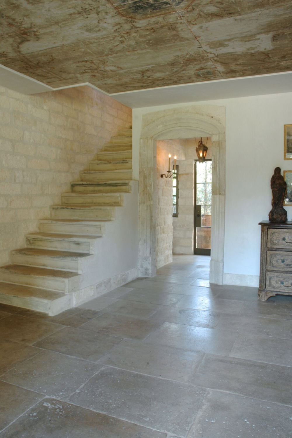 Chateau Domingue  - Ruth Gay's exquisite French home with reclaimed materials from Europe features stone staircase and wood planked ceilings.