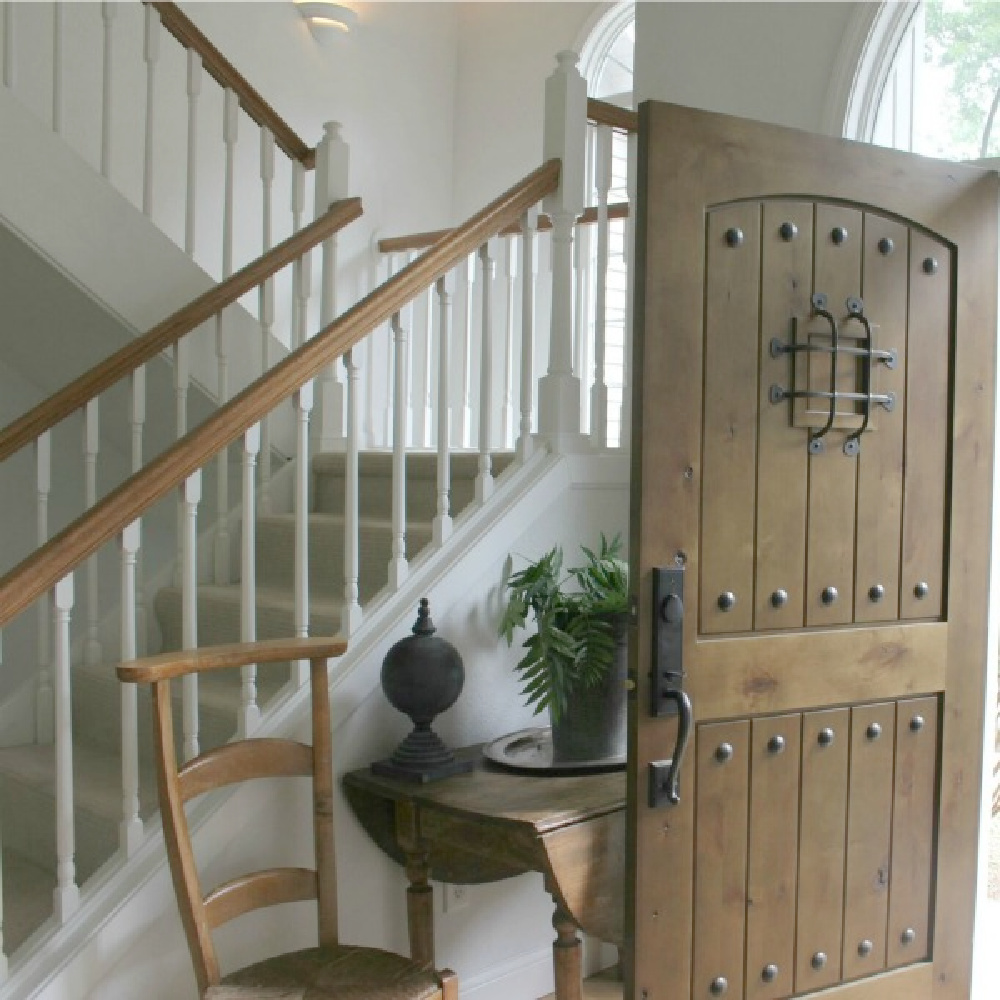 In our two story entry, a rustic alder planked front door with speakeasy makes a handsome statement - Hello Lovely.