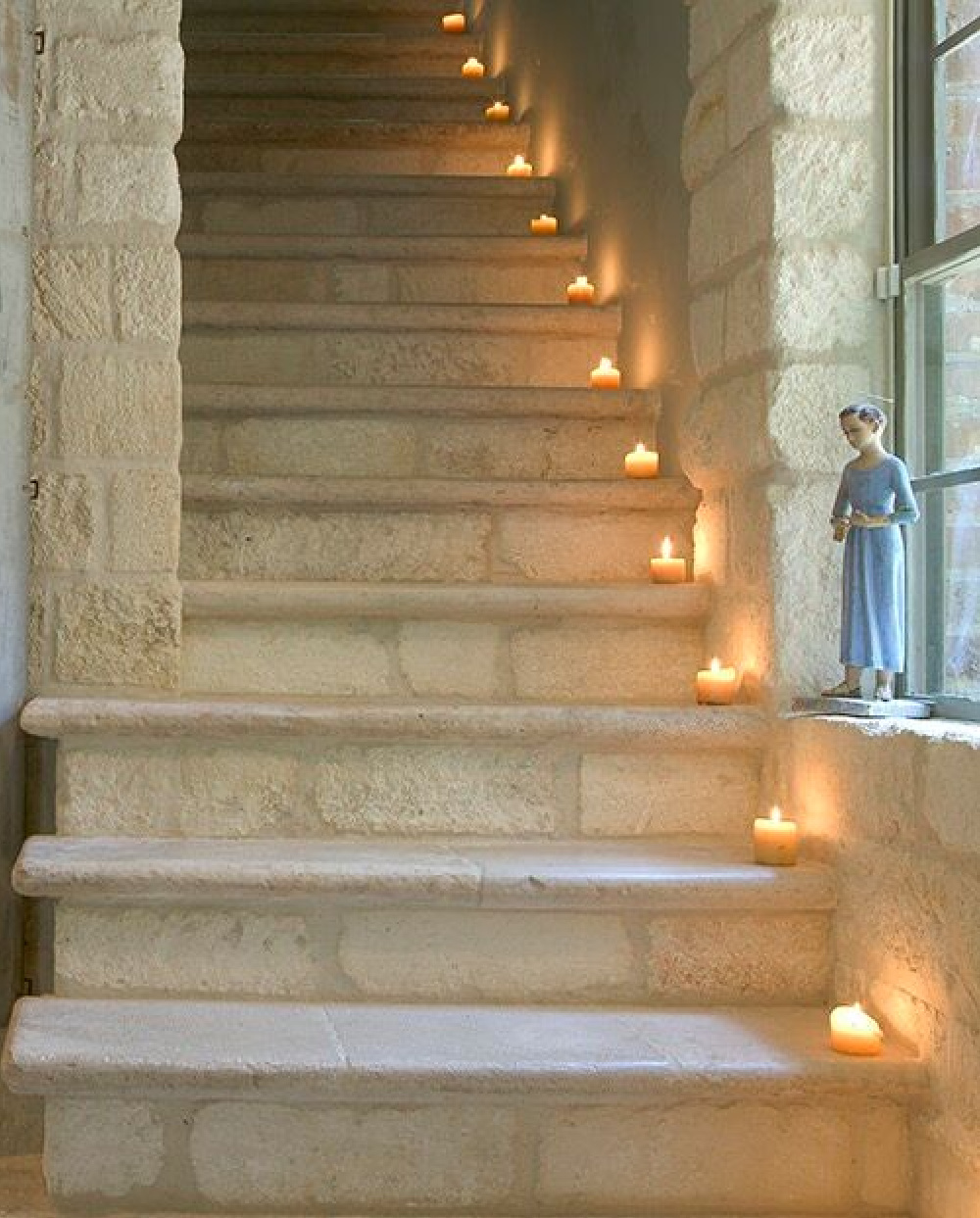 Breathtaking French limestone staircase in Ruth Gay's country French home - Chateau Domingue.