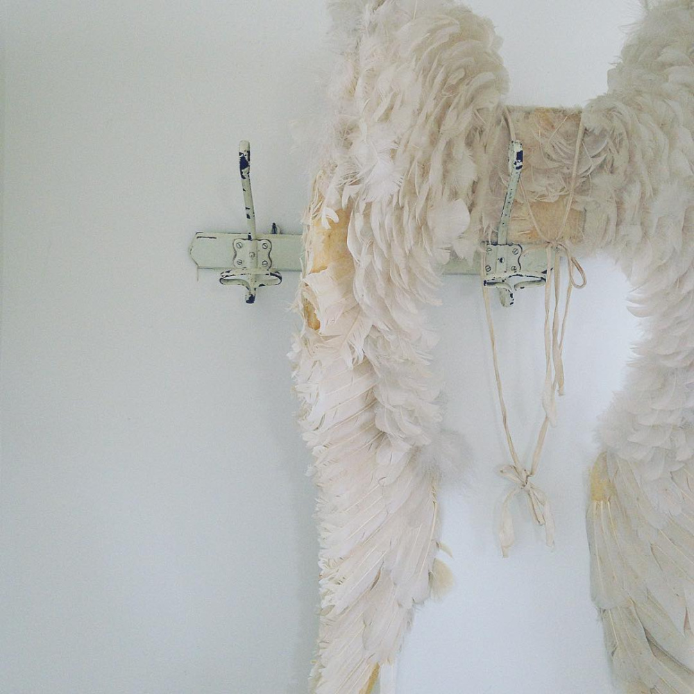 Antique angel wings in an all white Scandi cottage with French antiques and vintage - My Petite Maison.