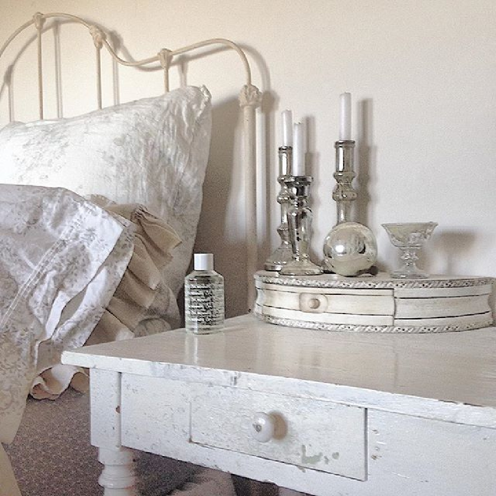 Charming and rustic white Scandi bedroom with iron vintage bed and country wood night table - My Petite Maison.