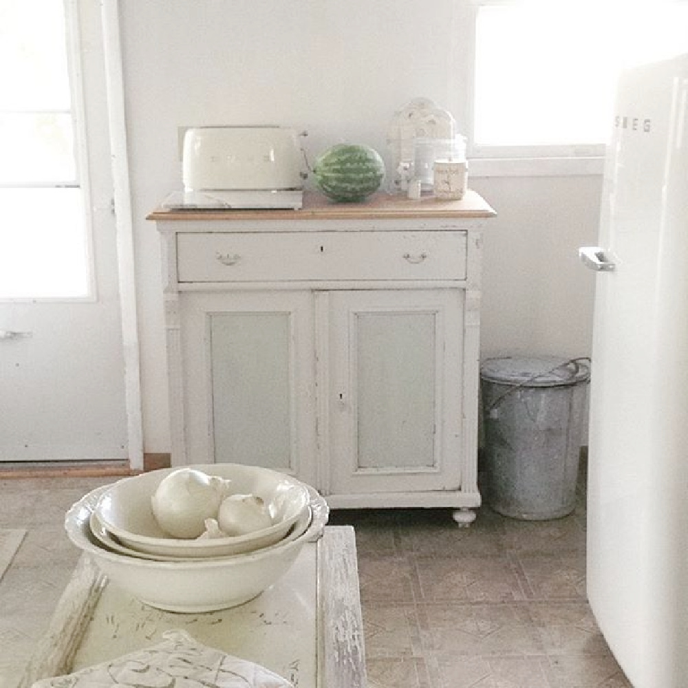 Ethereal and serene all white cottage kitchen with Smeg refrigerator and Swedish antiques - My Petite Maison.
