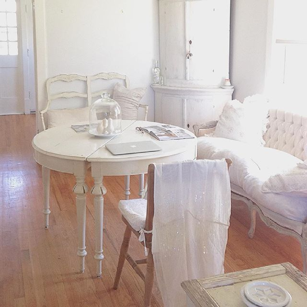 White painted rounded antique Swedish corner cabinet and French Nordic charm in a living room - My Petite Maison.
