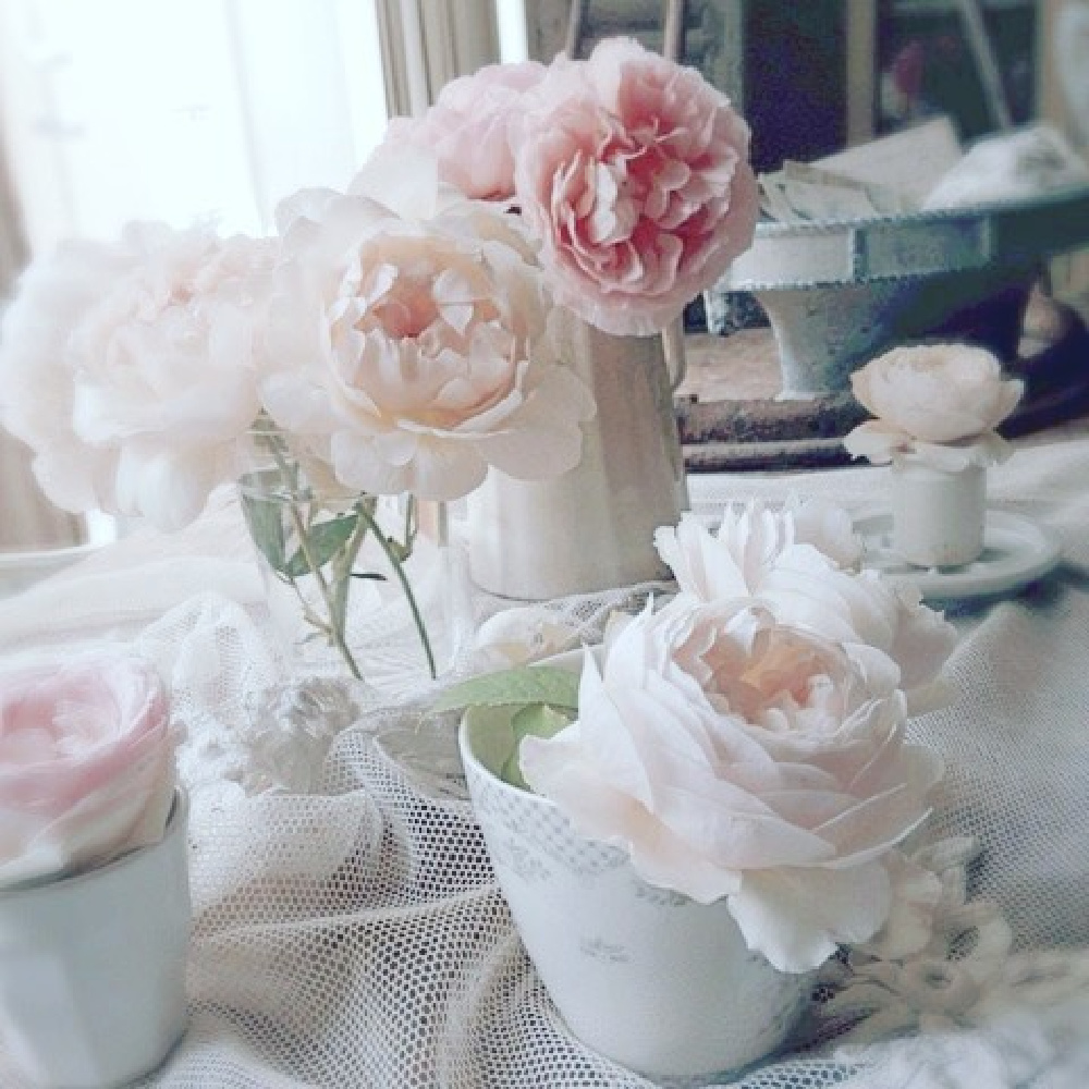 Blush pink garden roses styled with vintage china and French ironstone in a Swedish style cottage by My Petite Maison.