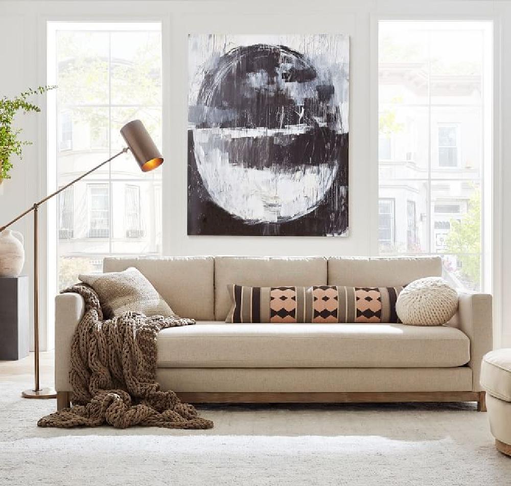 Neutral and classic sofa (Jake sofa) in a modern room - Pottery Barn. #jakesofa #livingroomsofas