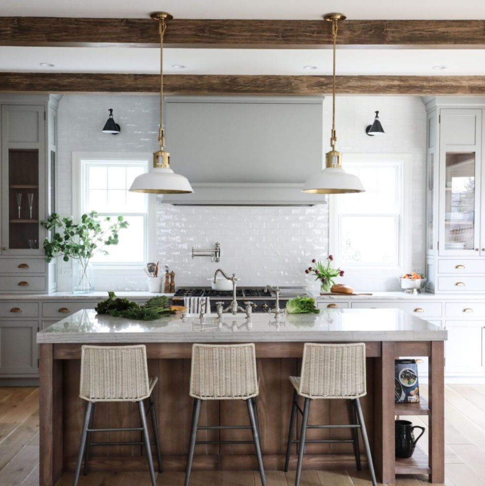 Lamp Room Gray (Farrow & Ball) paint color on cabinets in a beautiful custom kitchen with wood beams and subway tile - Park & Oak. #graykitchens #lamproomgray #paintcolors
