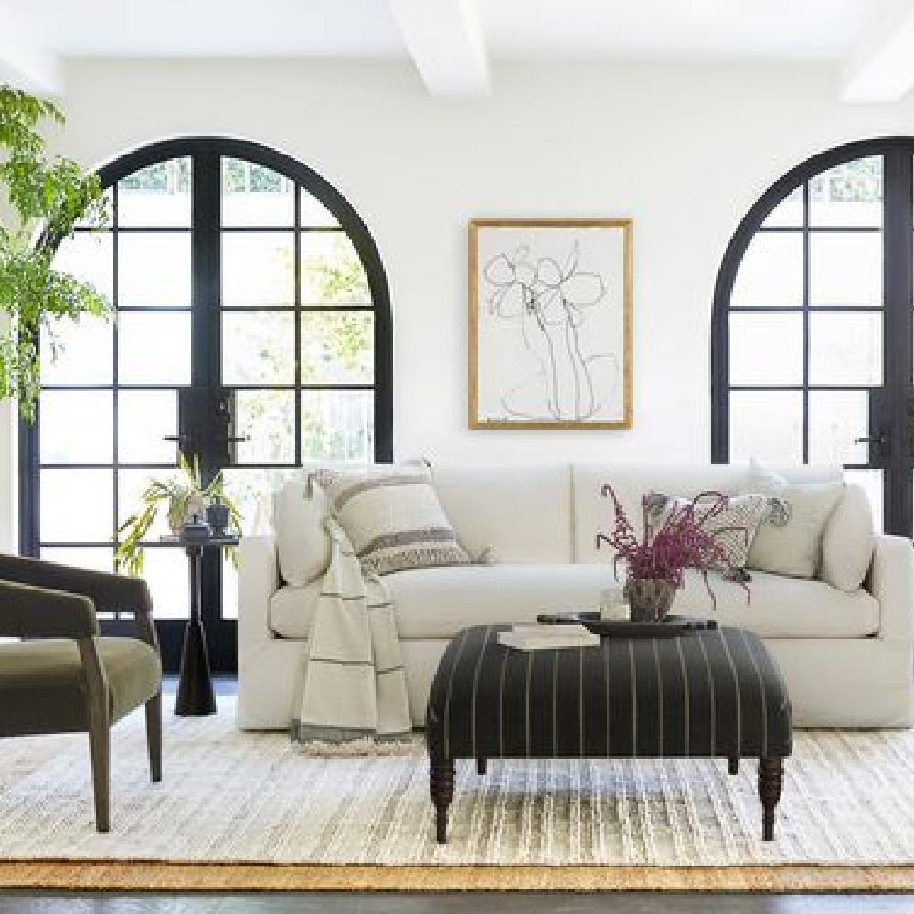 Black and white classic living room with Myla slipcovered sofa from Lulu & Georgia. #slipcoveredsofa #livingroomfurniture #whitesofas