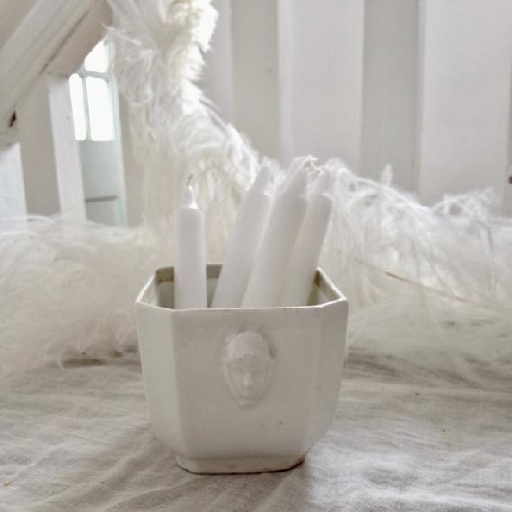 French antique faience sugar bowl holding white candles in a Nordic French cottage by @mypetitemaison.