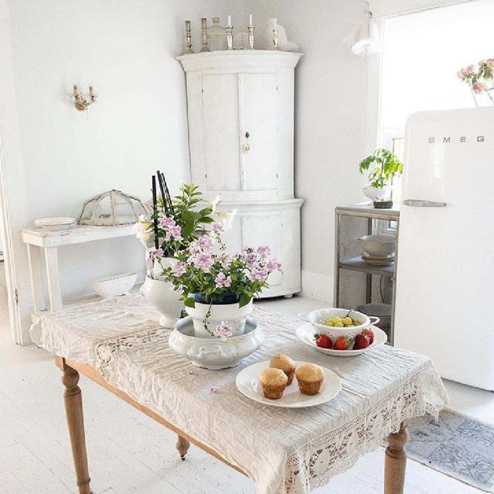 All white Nordic French kitchen, Swedish antiques, Smeg frig and white floors - My Petite Maison. #whitedecor #allwhite #nordicfrench #shabbychic #interiordesign #whitecottage #frenchnordic