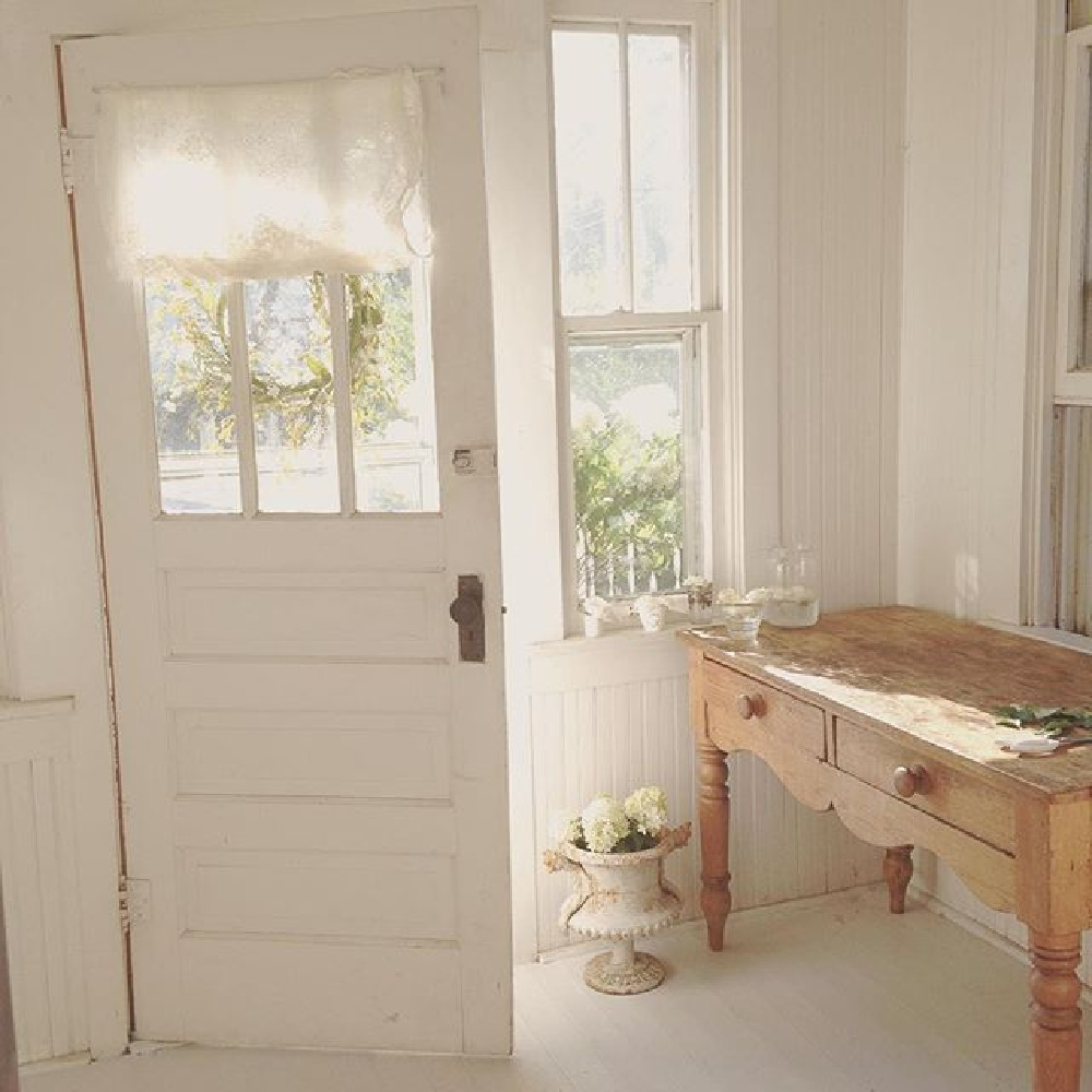 All white Nordic French cottage entry with ethereal mood and Swedish and French antiques - @mypetitemaison.
