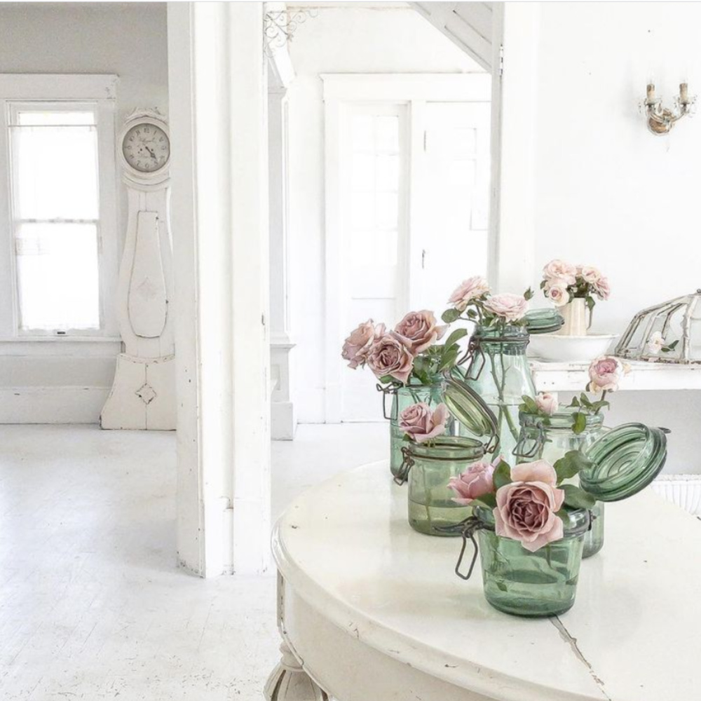 Lovely pink garden roses in green vintage jars within a white Nordic French home with antique Swedish mora clock - @mypetitemaison.