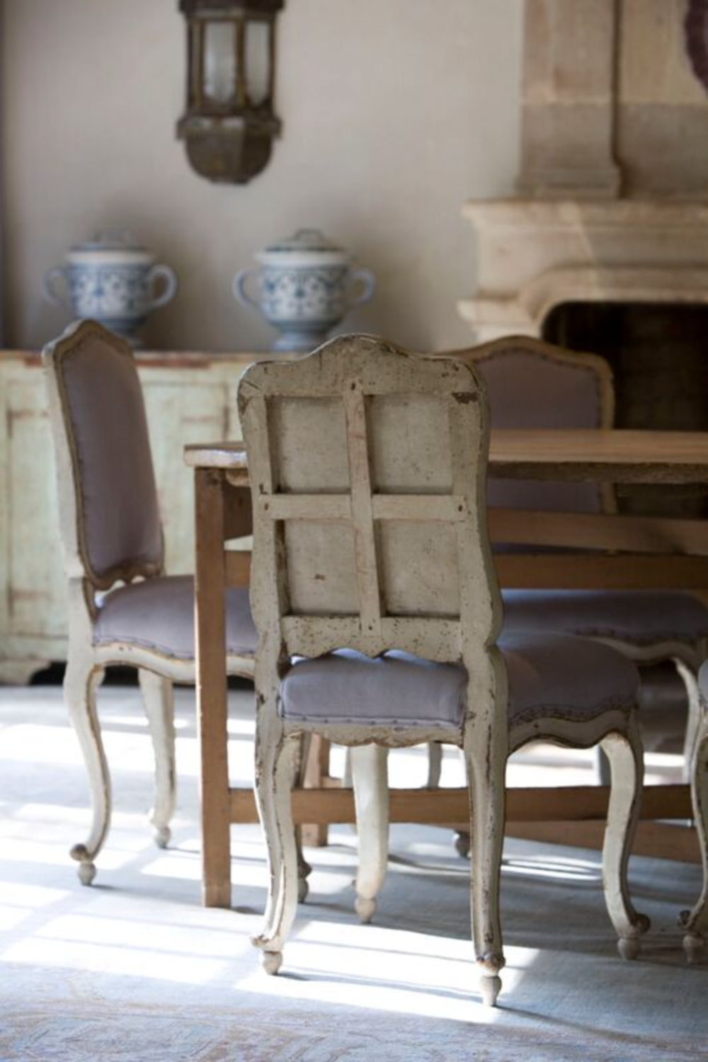 Rustic elegant French country dining room with authentic antiques and reclaimed materials from Chateau Domingue. #oldworldstyle #diningroom #countryfrench