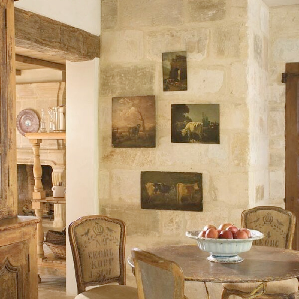 French kitchen with Old World style, stone walls, antique paintings, and charm from Chateau Domingue.