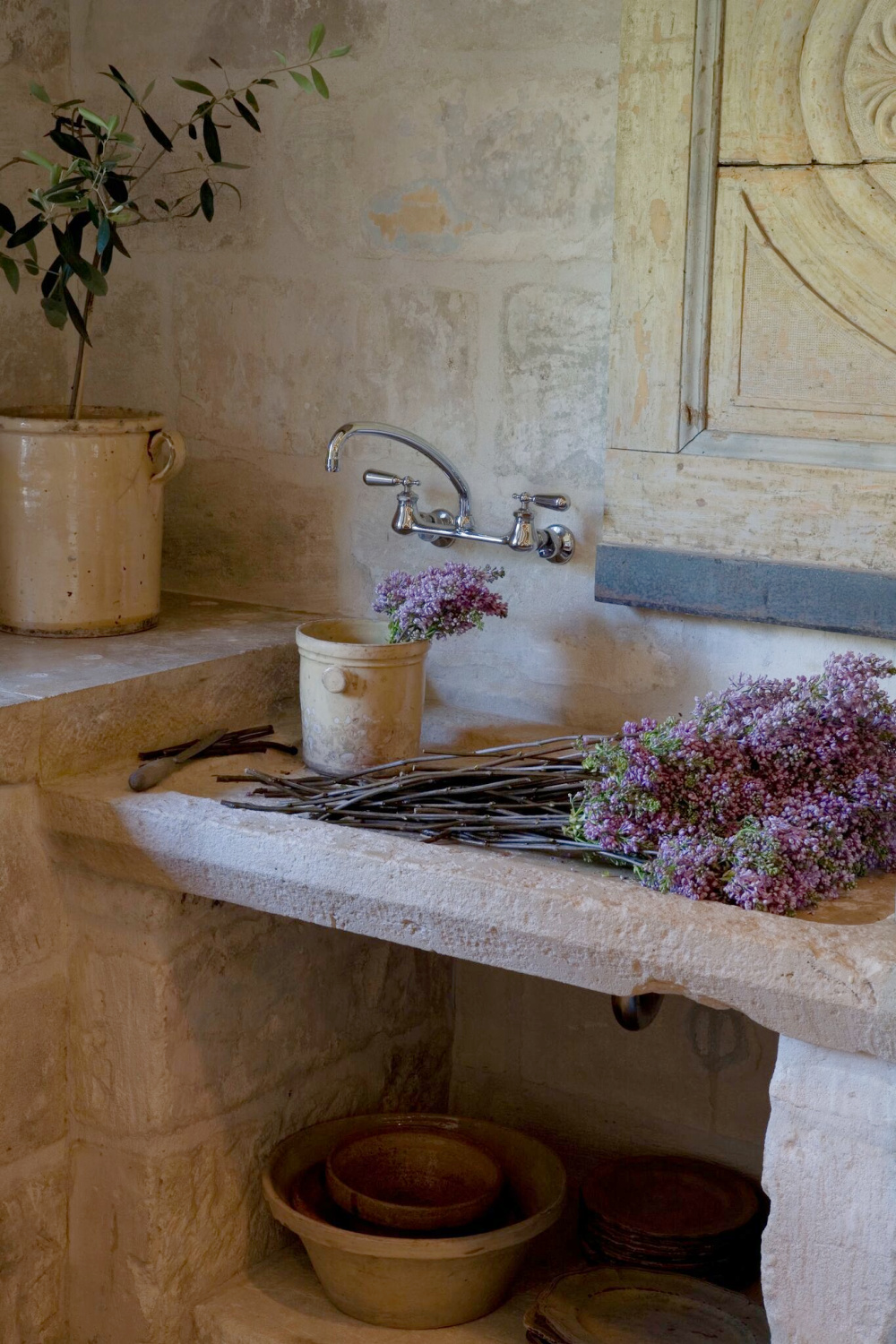 Country French romance and authenticity - rugged stone and French earthenware in Ruth Gay's stunning country French house in Houston - Chateau Domingue.