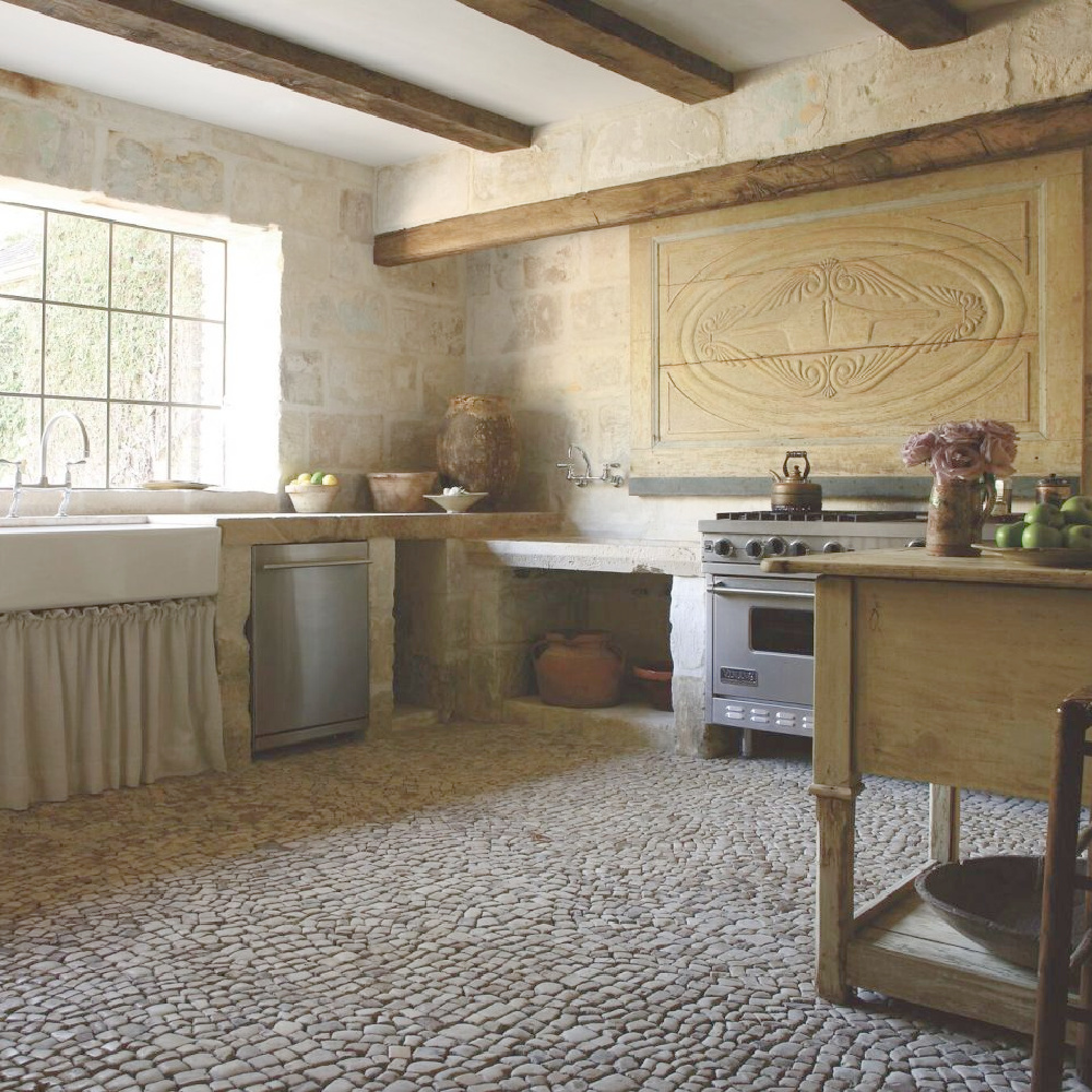 Authentic antique reclaimed materials from Europe in a newly built kitchen with Old World charm - Chateau Domingue. #frenchkitchen #frenchantiques #frenchlimestone #frenchcountry