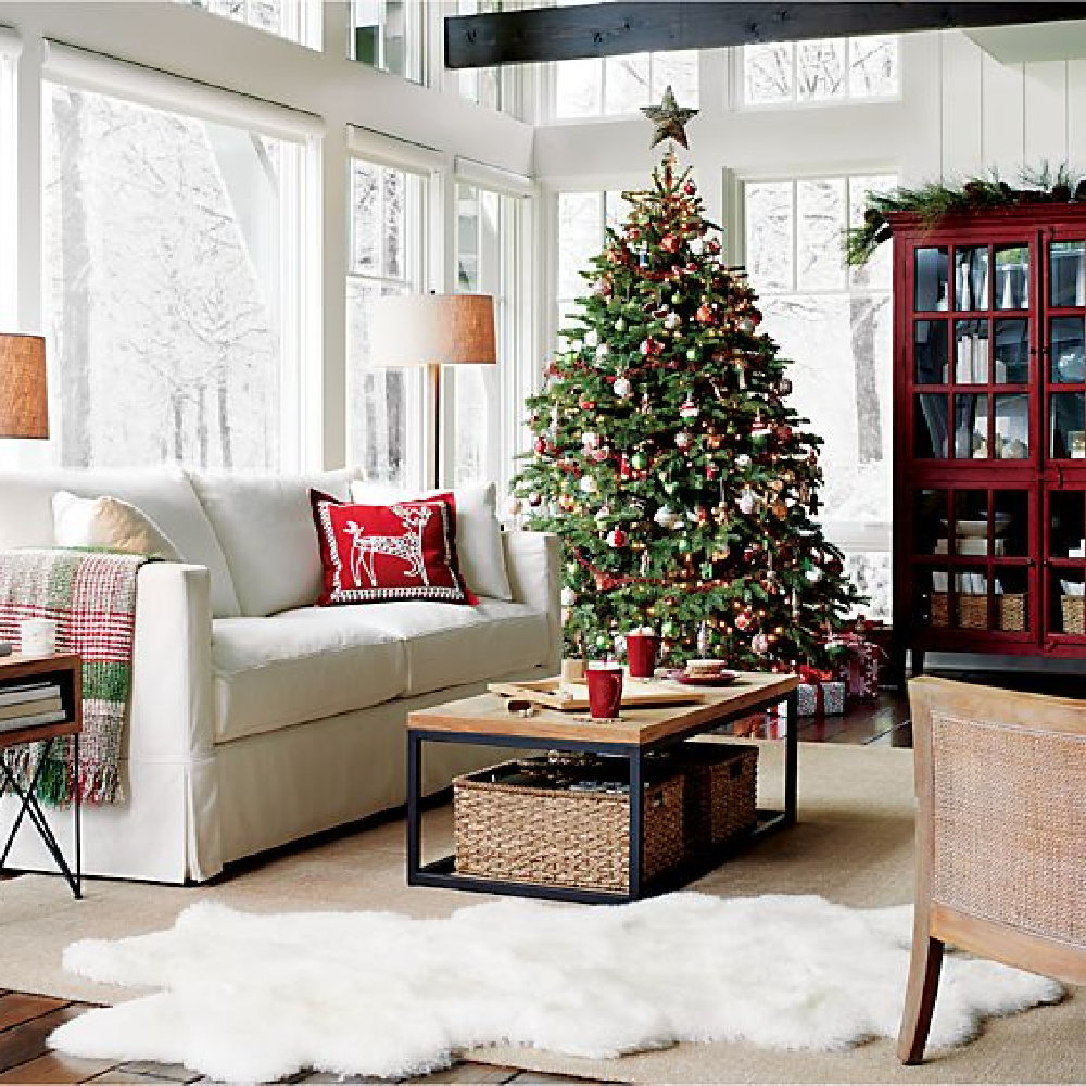 Family room decorated for Christmas with tree, garland, and Willow modern slipcovered sofa - Crate & Barrel. #holidaydecor #familyroom