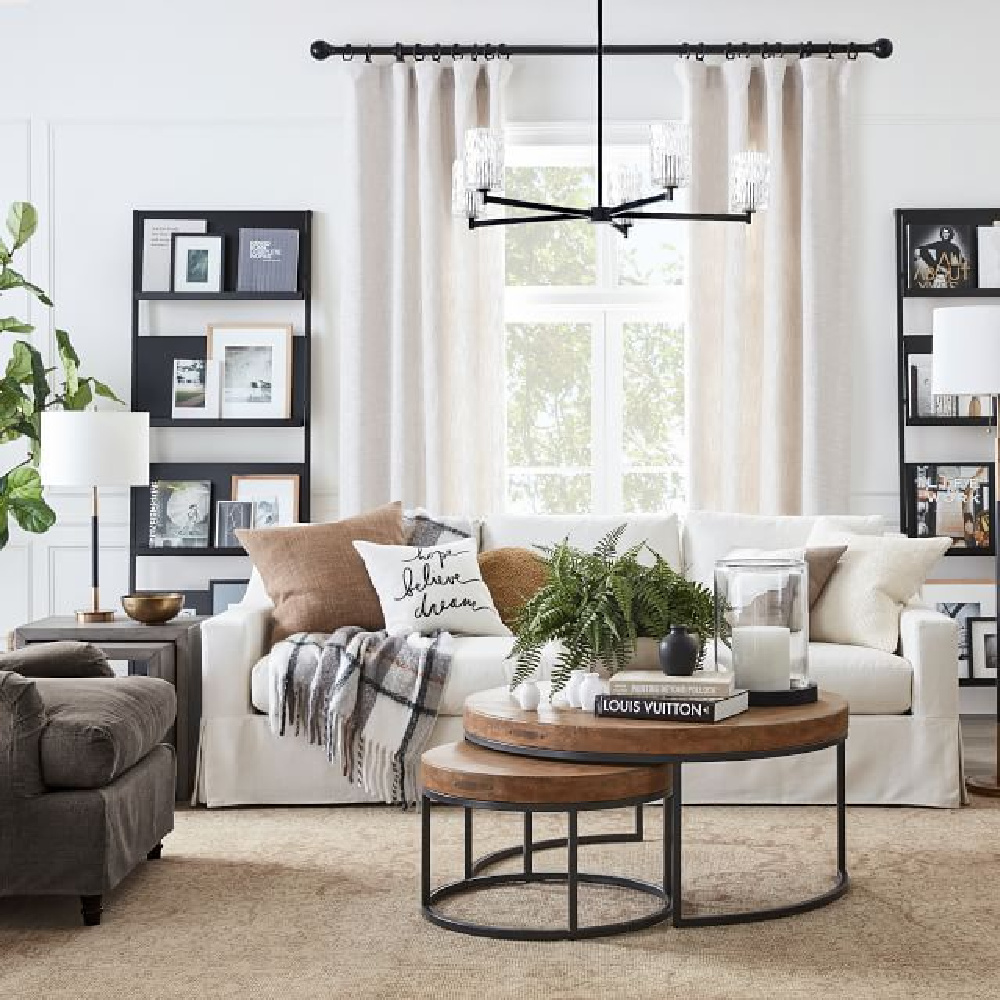 Neutral and modern rustic family room with York Slope Arm Sofa from Pottery Barn and nested Maxwell round coffee tables. #modernrustic #familyroom #yorkslopearmsofa