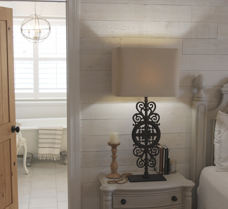 French country Nordic bedroom with Stikwood Hamptons wallcovering and bathroom with clawfoot tub. #hellolovelystudio #mastersuite #frenchcountry #frenchnordic #stikwood #hamptons #cottagestyle #bedroomdecor #clawfoottub