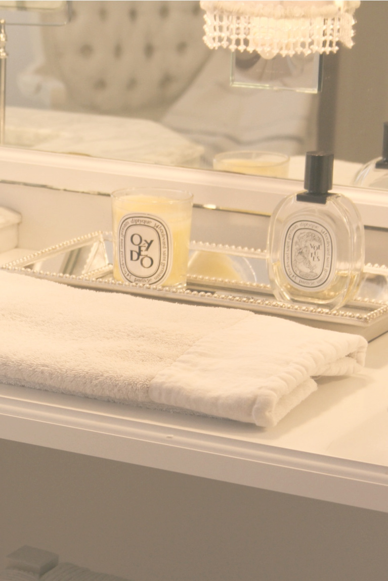 Diptyque on a mirrored tray on my makeup counter - Hello Lovely Studio.