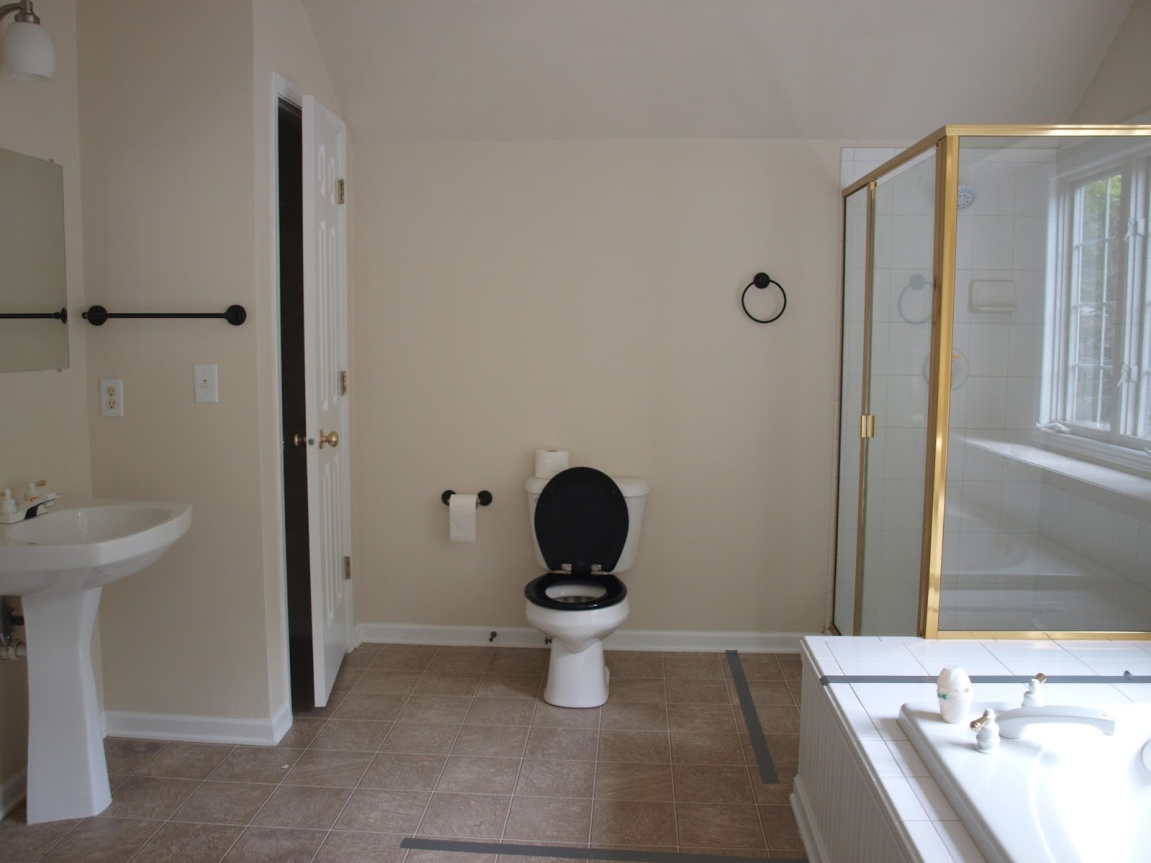 before pic of Hello Lovely Studio's master bathroom renovation