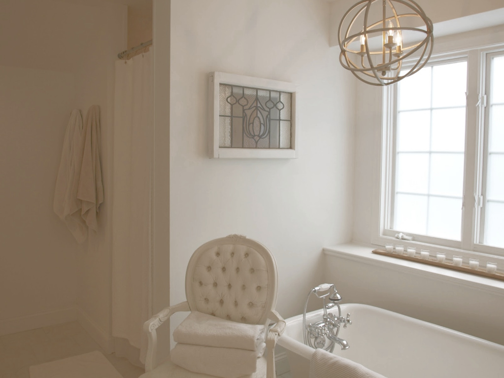 View of shower and tub area of our renovated French country master bathroom. #hellolovelystudio #frenchcountry #bathroom