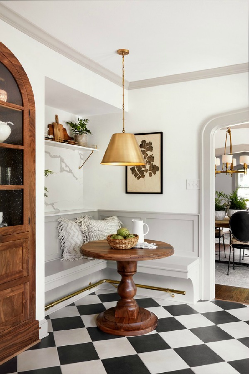 Scrivano episode kitchen breakfast nook with bnquette! Tranquil Tudor cottage renovated on HGTV's Fixer Upper by Chip and Joann. #scrivano #breakfastnook #banquette #checkfloor