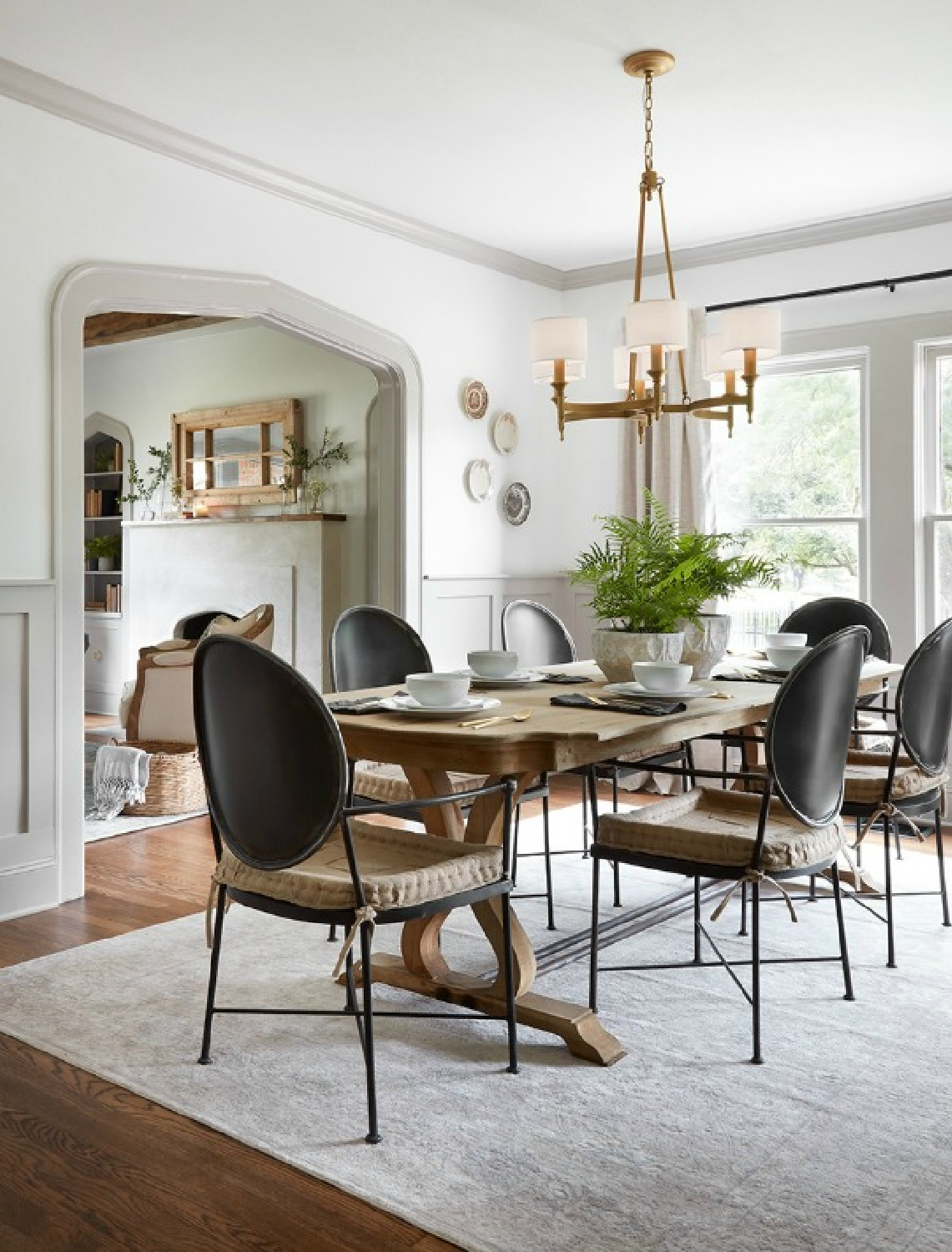 Scrivano dining room: modern Louis style black dining chairs,, grey trim, white walls, neutral classic style. Come get the Look of the Scrivano Tudor renovated by Joanna & Chip on HGTV's FIXER UPPER! #scrivano #fixerupper #diningroom