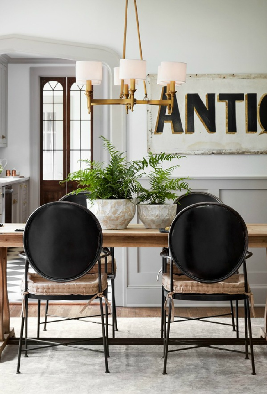 Get the Look: Scrivano FIXER UPPER Cottage Decor! Charming vintage style dining room's modern Louis chairs and tranquil palette. #scrivano #fixerupper #diningroom #joannagaines #greytrim