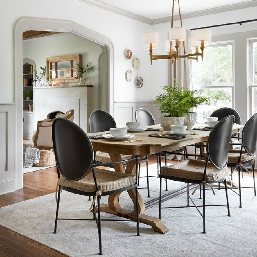 Light grey trim, white walls, and neutral elegant classic dining room. Come get the Look of the Scrivano Tudor renovated by Joanna & Chip on HGTV's FIXER UPPER! #scrivano #fixerupper #diningroom