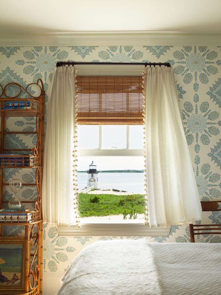 Tom Scheerer designed coastal wallpapered blue and white bedroom in a Nantucket seaside home. Photo by Tria Giovan for Jennifer Ash Rudick's Summer to Summer. #coastalstyle #bedroomdecor #coastalbedroom #interiordesign #blueandwhite #wallpaper #lighthouse