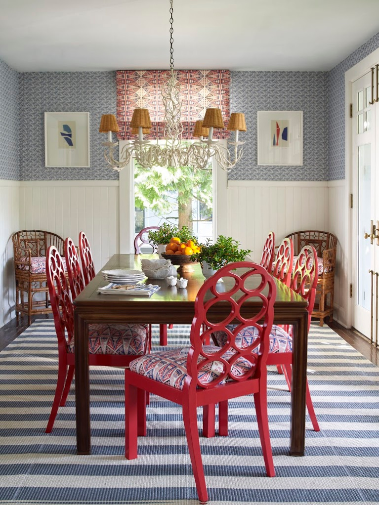 Meg Braff Designs' Swirls wallpaper in navy, combined with roman shades and seat cushions in China Seas' Malay Stripe in a breakfast room. Chairs are Francis Elkins Loop chairs in a Chinese vintage red. #interiordesign #traditionalstyle #megbraff #diningrooms #redwhiteblue #colorfulrooms