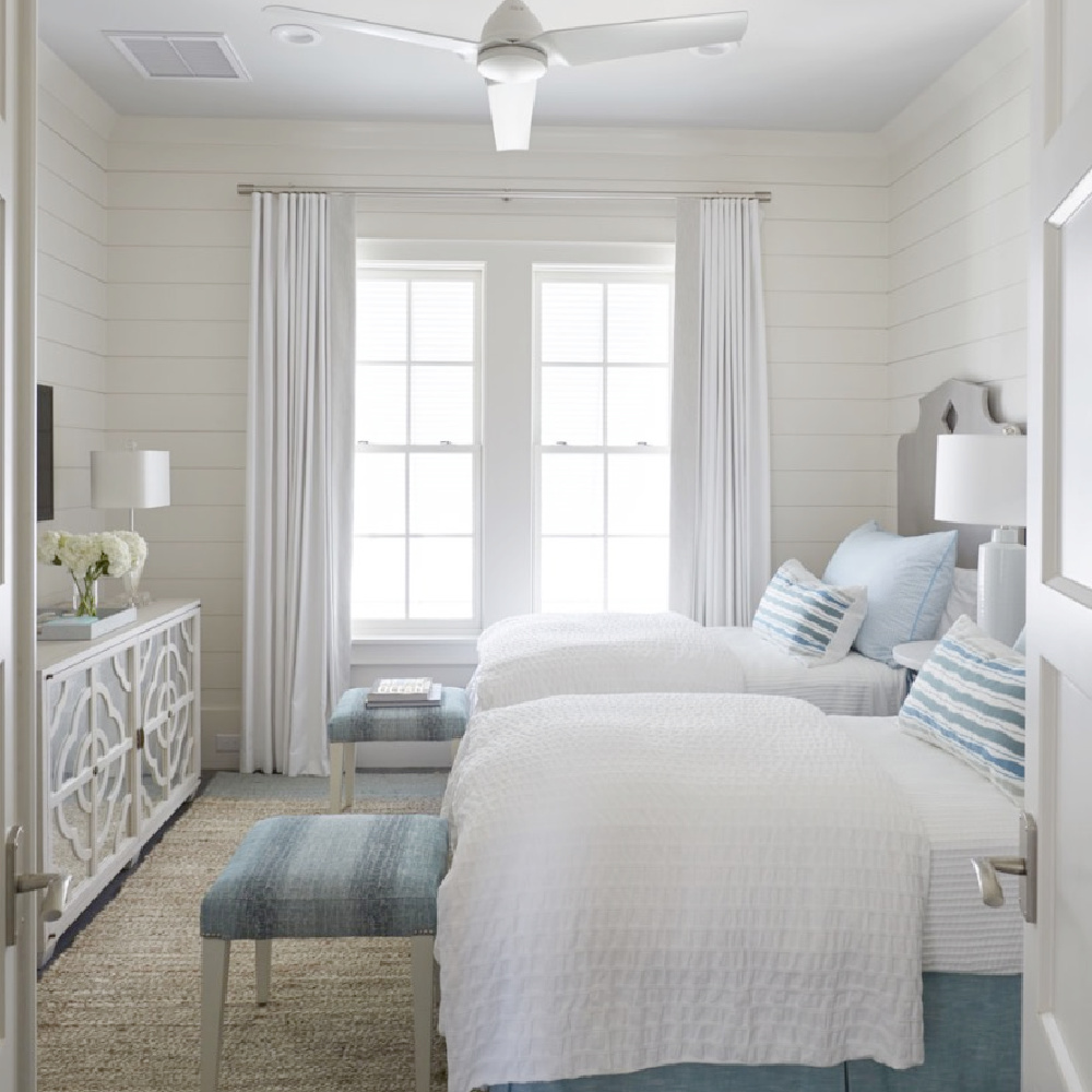 Breezy and chic coastal bedroom with blue accents and ottoman bed benches - architecture: Geoff Chick.