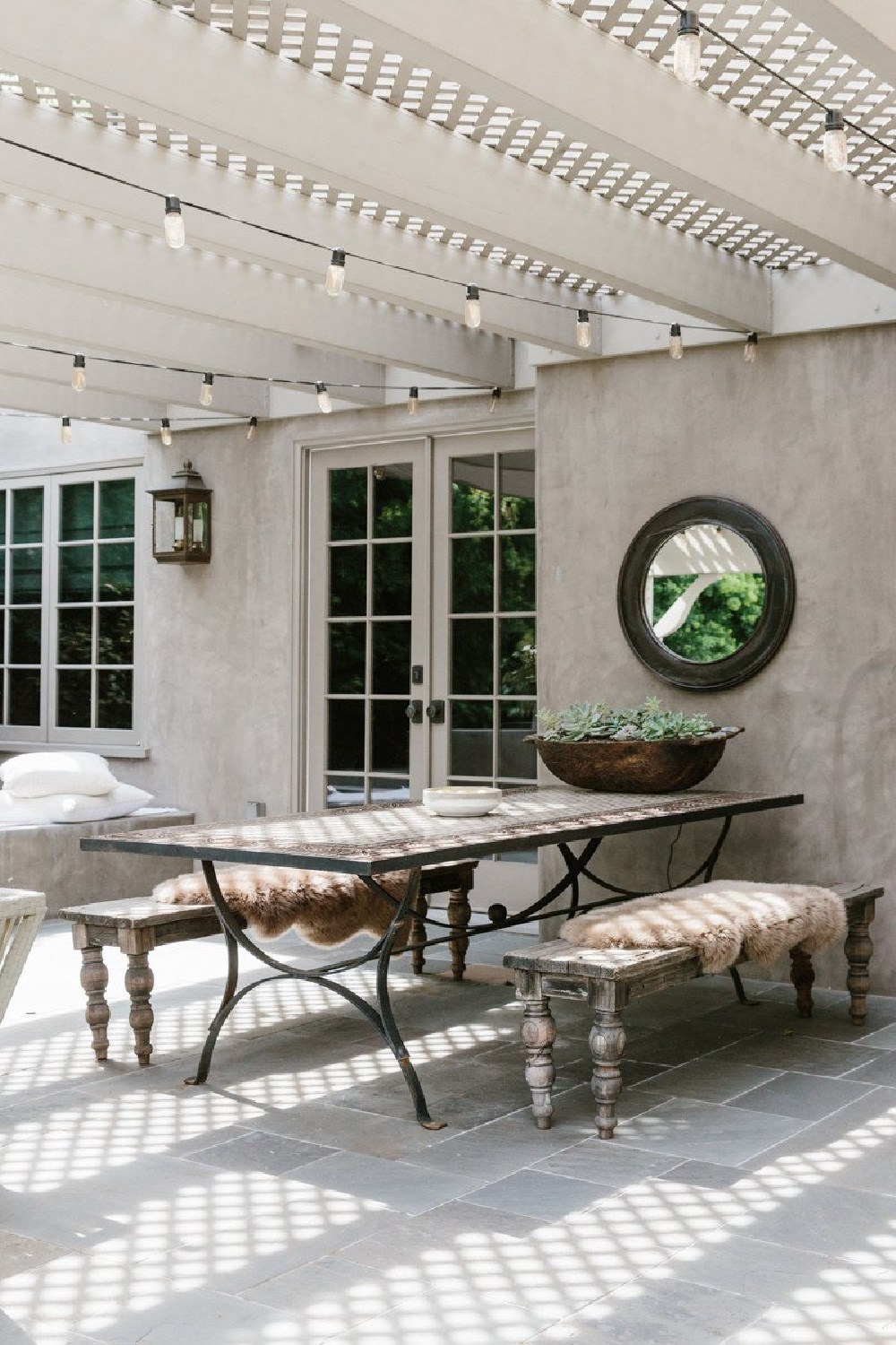 Erin Fetherston outdoor dining area with rustic benches and pergola. Come explore California modern farmhouse style and score ideas to get the look!