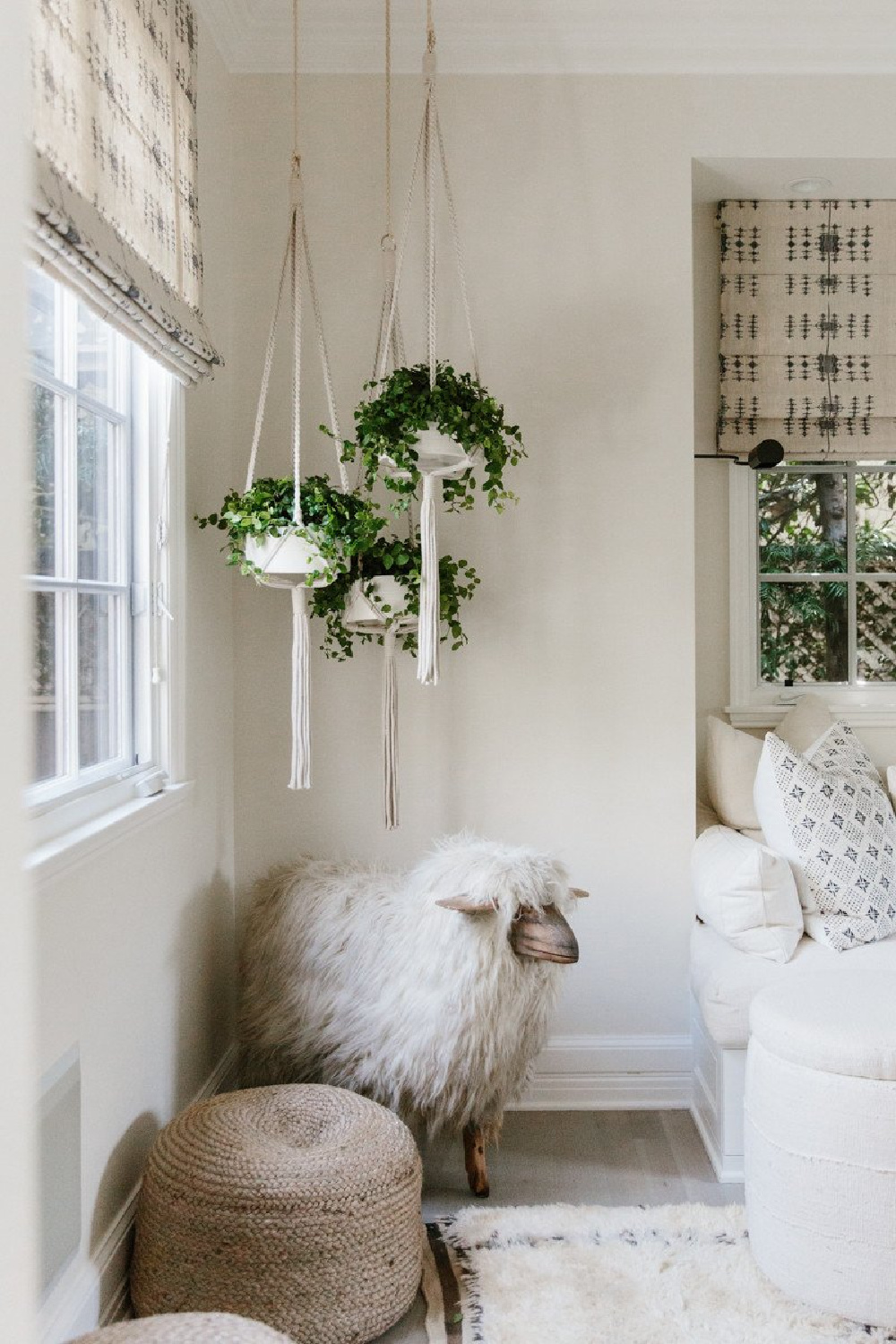 California modern farmhouse decor with hanging plants in Erin Fetherston home. Come explore more California modern farmhouse design inspiration!