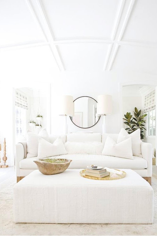 Erin Fetherston's white living room in LA. Come explore California modern farmhouse interior design inspiration! #modernfarmhouse #livingrooms #whitedecor #interiordesign