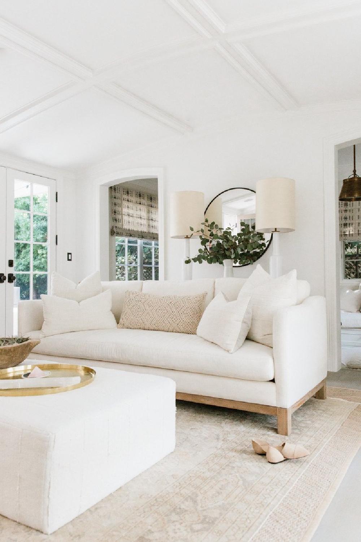 Erin Fetherston's white living room in LA. Come explore more California modern farmhouse interior design inspiration! #modernfarmhouse #livingrooms #whitedecor #interiordesign