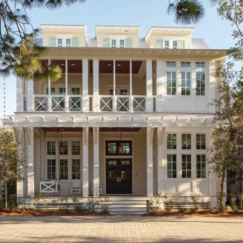Magnificent coastal home exterior (architecture: Geoff Chick) with bracketed entry trellis and magnificent porch. #coastalhomes #beachhouses