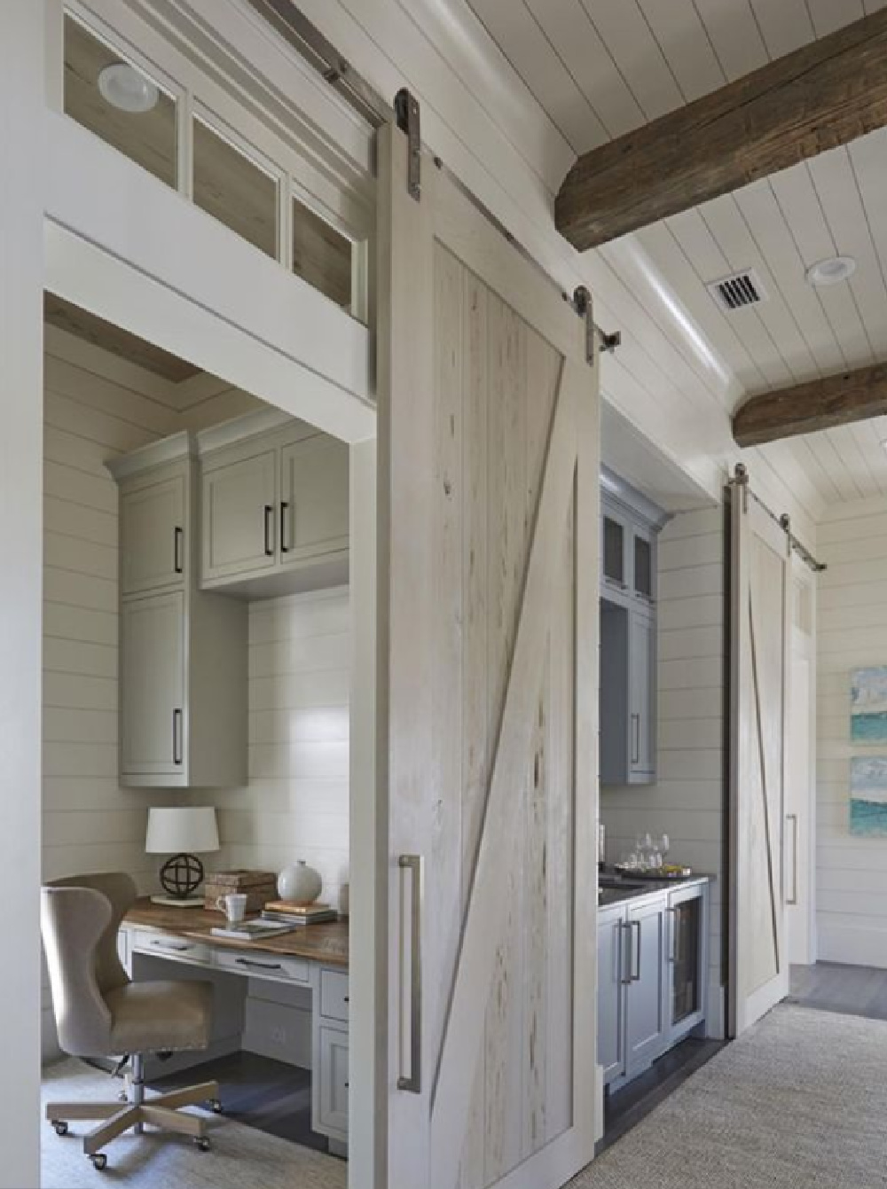 Home office with barn door, transom, and shiplap in a classic coastal home with architecture by Geoff Chick & Associates. #homeoffice #shiplap #coastalstyle