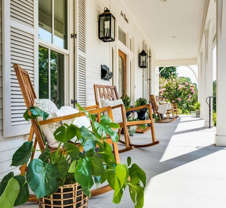 Charming front porch on a Southern home by Garden Gate Homes. Come peek at  Charming Porch Inspiration & Decor Ideas. #frontporches #southernhomes #houseexteriors #porchdecor #porches