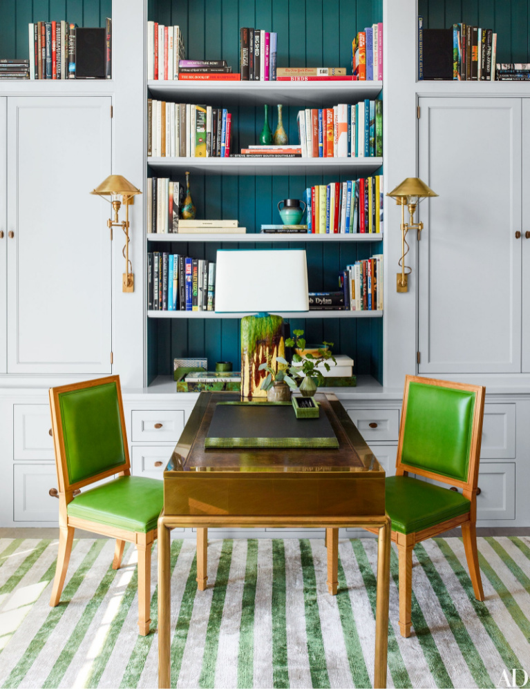 Breathtaking home office with built-ins and vivid green - Steven Gambrell. #homeoffice #interiordesign #brightgreen #builtins