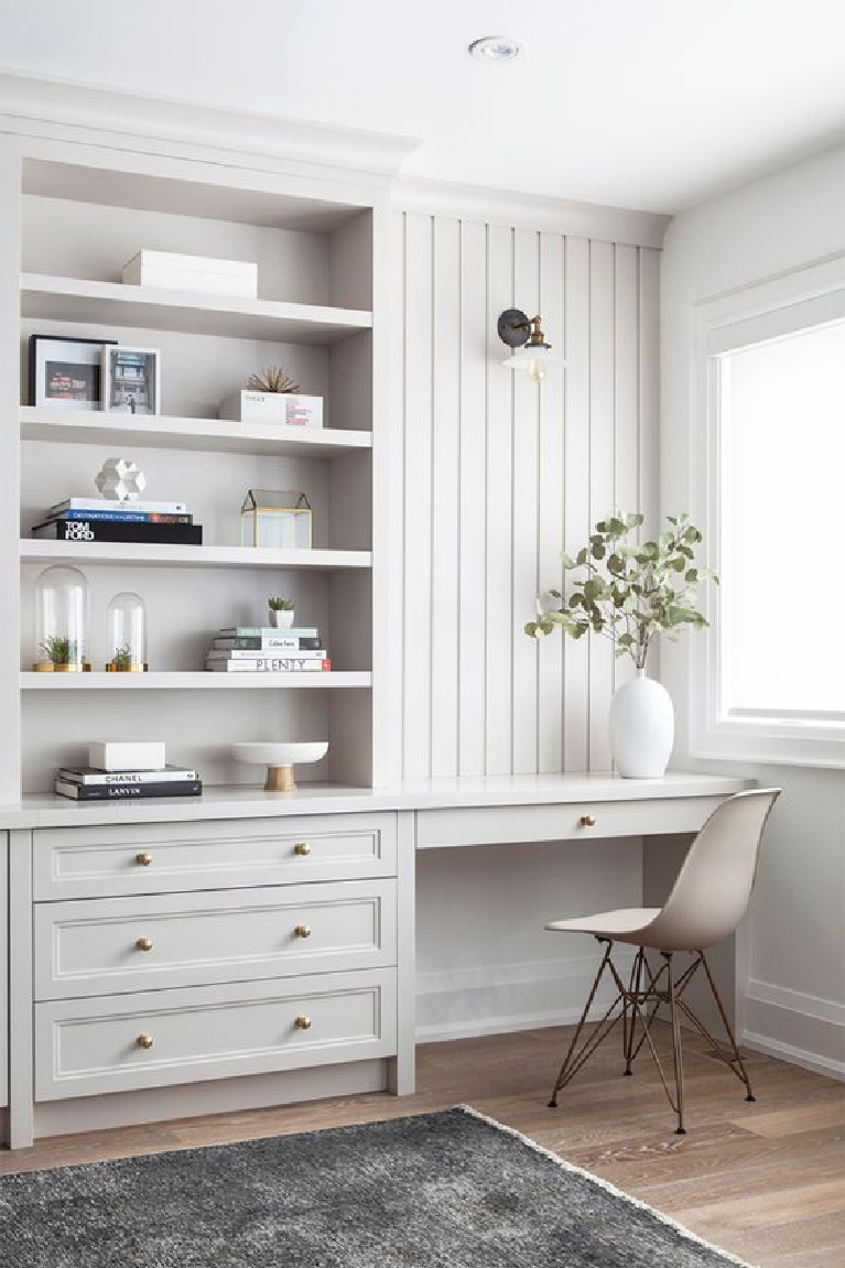 Beautiful grey painted custom millwork in the home office of a Toronto home - design by Collective Studio. #homeoffice #builtins #interiordesign #millwork #serenedesign