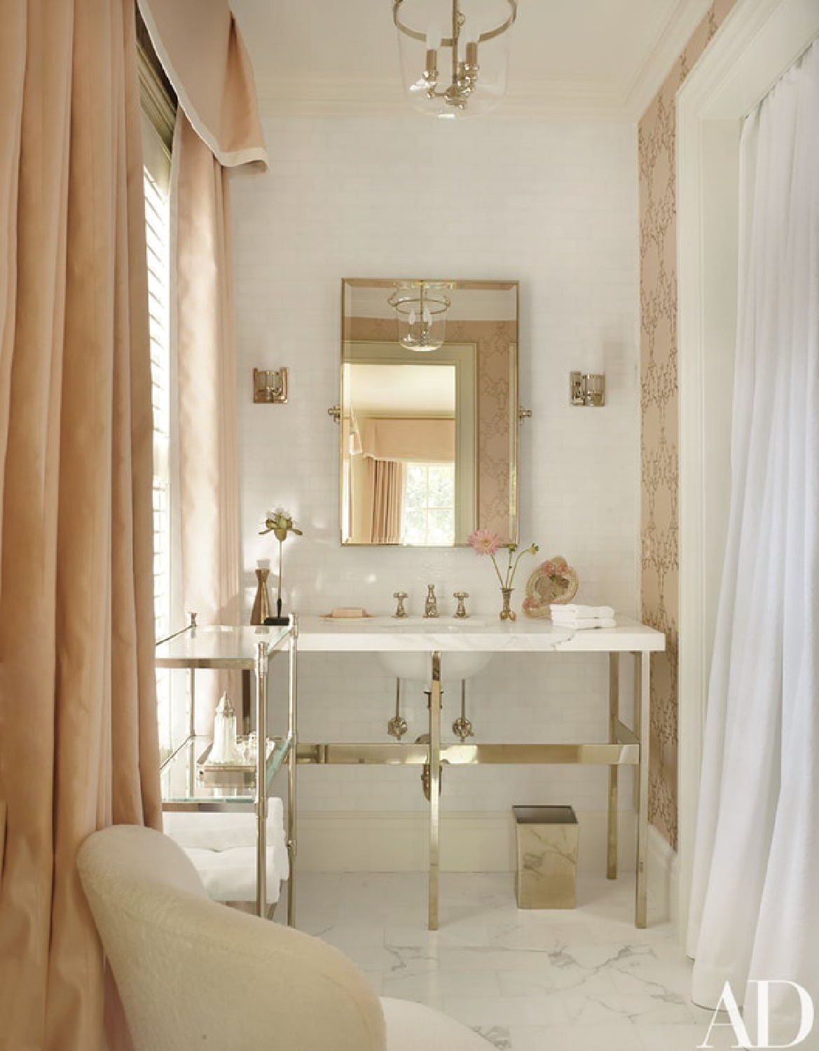 Intimate White (Sherwin Williams) pale pink paint color in Suzanne Kasler designed luxurious bath with pink curtains. #intimatewhite