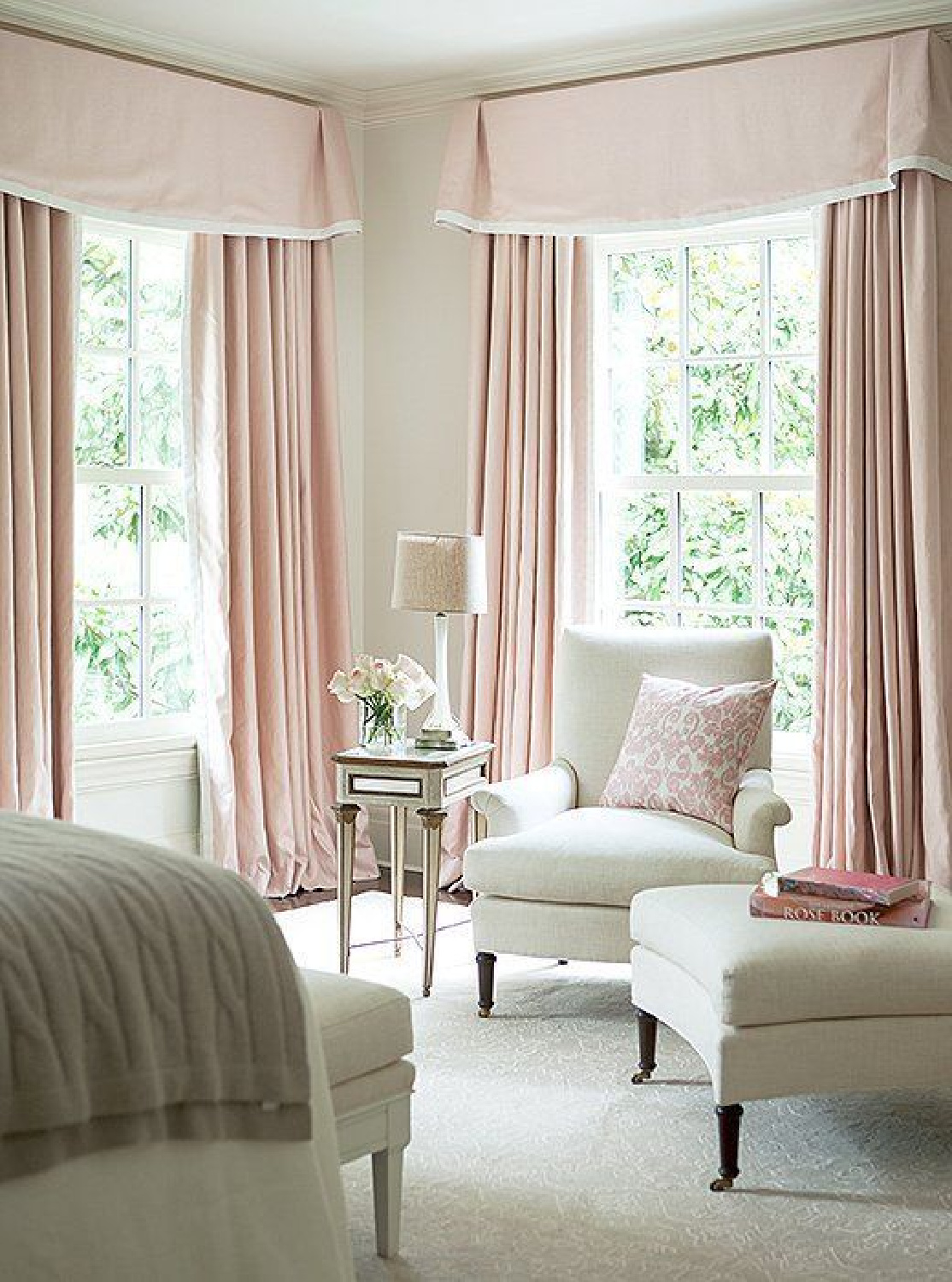 Intimate White (Sherwin Williams) pale pink paint color in Suzanne Kasler designed bedroom with pink curtains. #intimatewhite