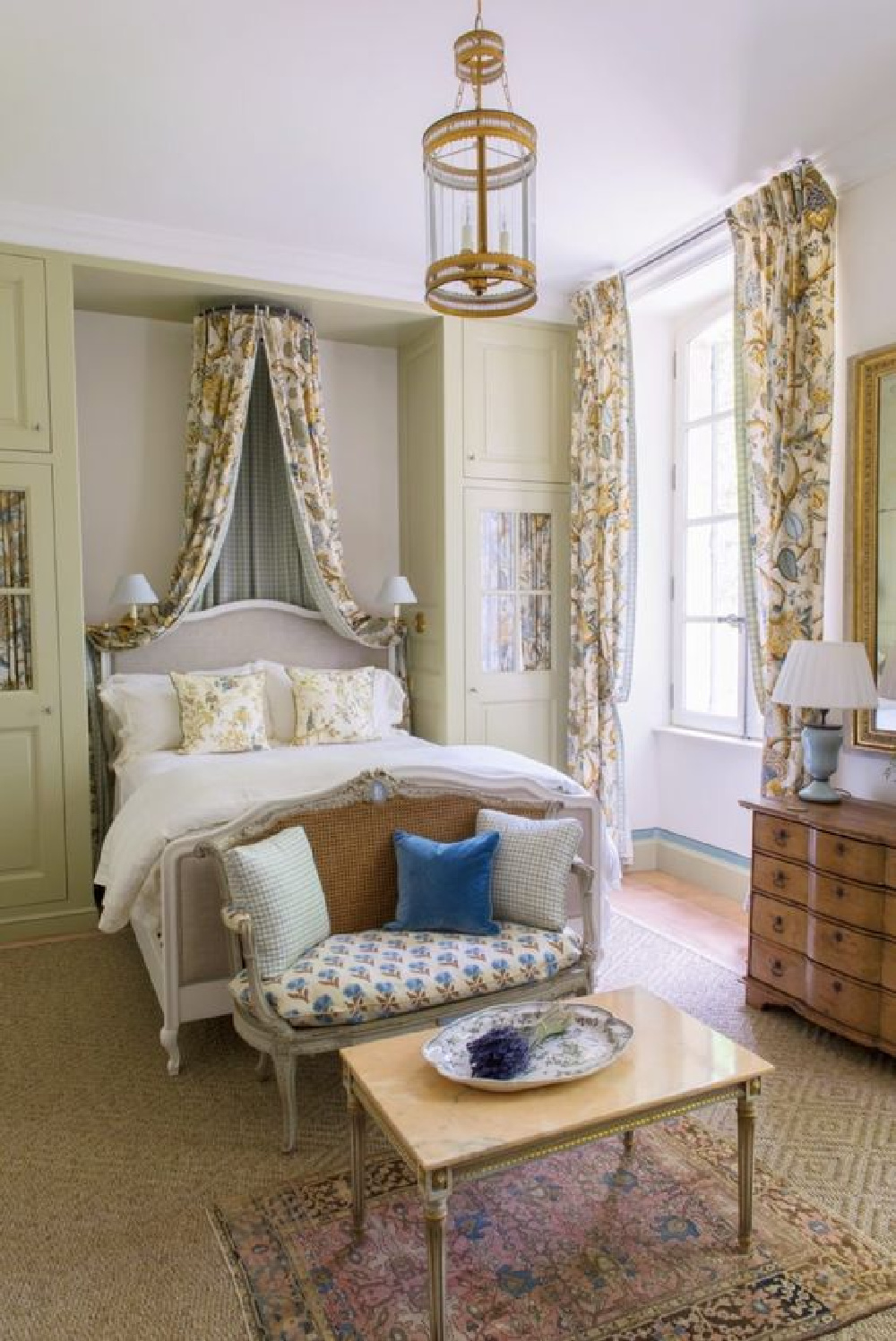 Pierre Frey fabrics and traditional style in a breathtaking French country bedroom in a Provence farmhouse (Le Mas des Poiriers).