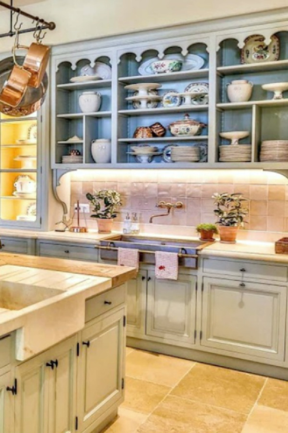 Light blue kitchen cabinets and zellige tile backsplash in a historic French farmhouse in Provence (Le Mas des Poiriers).