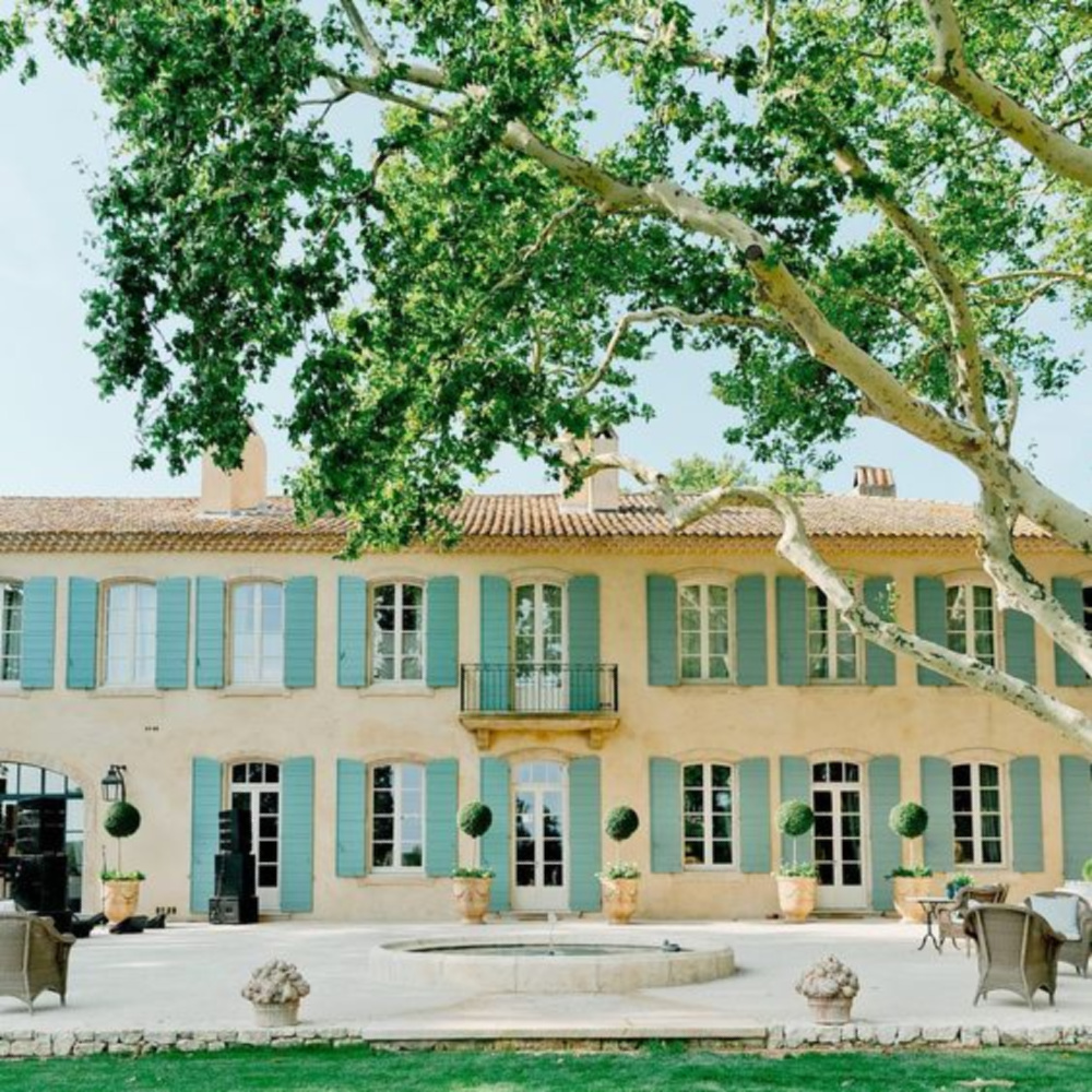 Provence French farmhouse exterior with blue-green shutters - Le Mas des Poiriers.