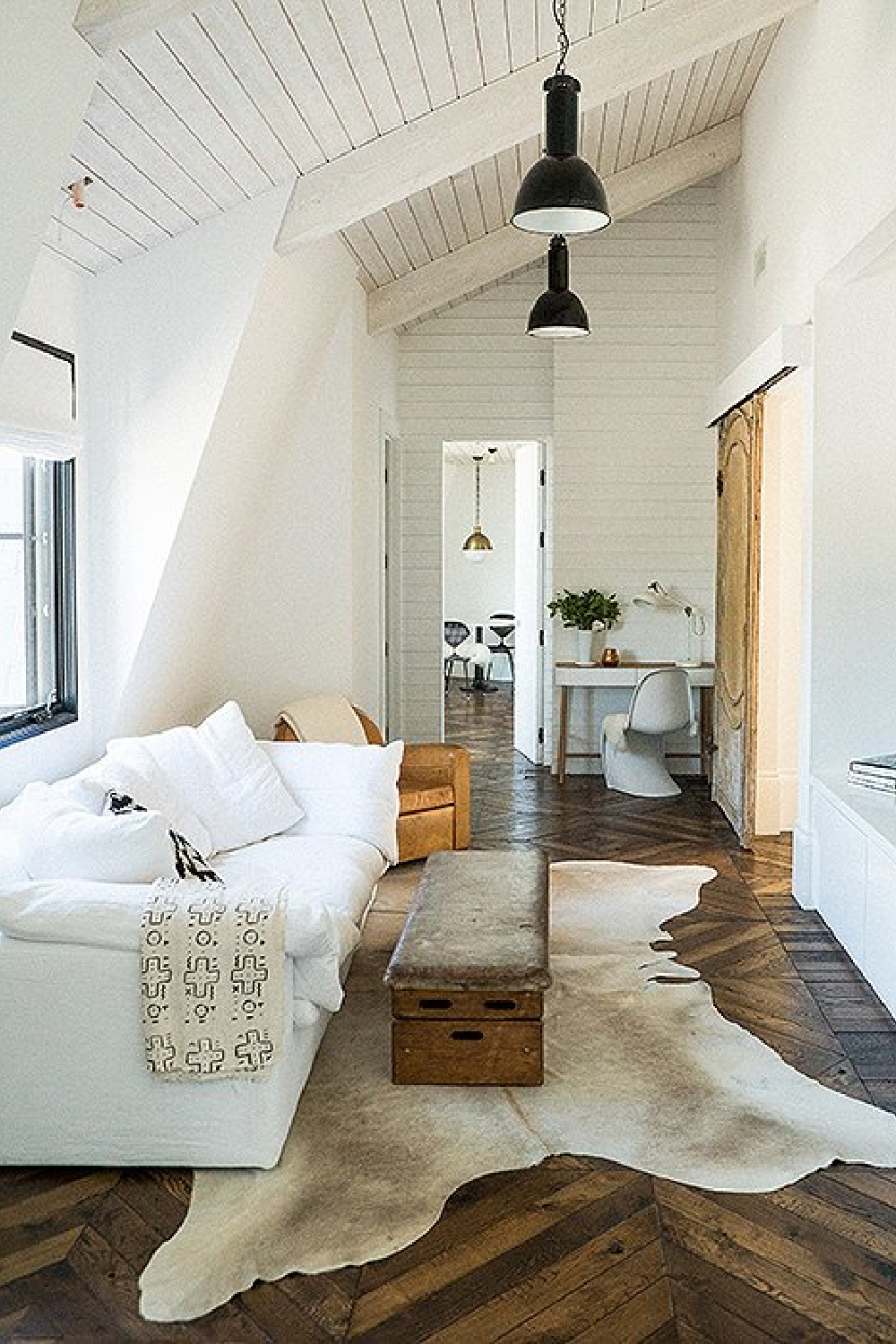 Leanne Ford designed modern rustic interior design with white sofa, white walls and black accents.