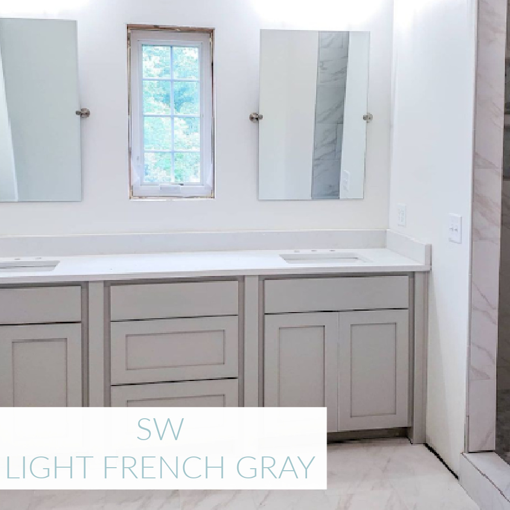 Light French Gray (SW) painted vanity cabinets in a bath by @homeonspringwood. #lightfrenchgray #swlightfrenchgray #paintcolors