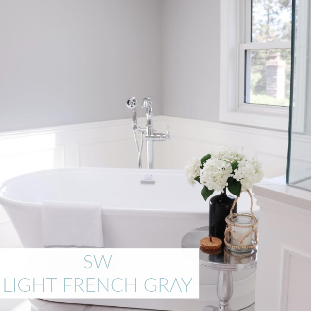 Light French Gray SW paint color in a luxurious bath by @thisprettylifexo. #lightfrenchgray #greypaintcolors #sherwinwilliamslightfrenchgray
