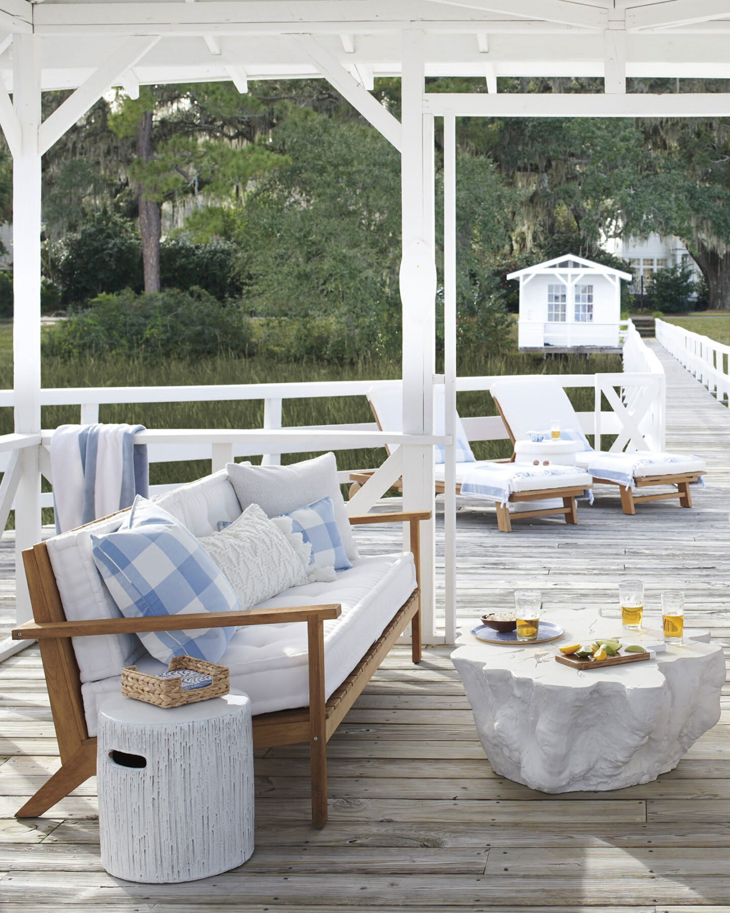 Coastal design inspiration on this porch with Serena & Lily blue check pillows and furniture. #serenanadlily #coastalstyle #porchdecor #homedecor #furniture #summerliving #outdoorliving